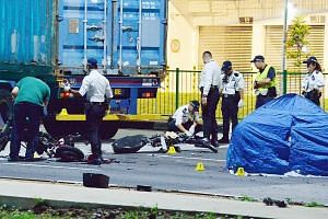 The accident site at the junction of Pandan Crescent yesterday. The 34-year-old driver of the trailer was arrested on suspicion of causing death by negligence. E-bike users Ang Yee Fong and Ong Zi Quan died, while a third, Marcus Loke, sustained inju