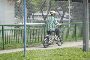 An e-bike rider along Sembawang Road on Oct 28, 2016.