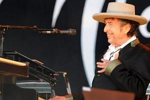 US poet and folk singer Bob Dylan performing during the 21st edition of the Vieilles Charrues music festivalin Carhaix-Plouguer, western France, on July 22, 2012.