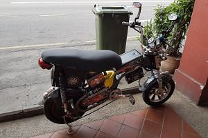 Despite sporting the blue LTA tag - above the bike chain - that identifies it as an approved model, this e-bike seen parked on Geylang Road yesterday has been so heavily modified, it resembles a motorcycle.