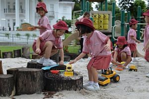 Children from a nursery class at St James' Church Kindergarten playing outdoors on Sept 16, 2016.