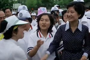 Media footage showing Ms Choi (left) and Ms Park at a Seoul university event in 1979.