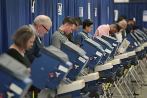 Residents cast ballots for the November 8 election at an early voting site on Oct 18, 2016 in Chicago, Illinois.
