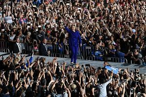 Mrs Clinton greeting the crowd at a rally in Tempe, Arizona, on Wednesday. Early voting tallies indicate that Democrats are turning out in greater numbers than Republicans in some states, an advantage for her, experts say. But the turnout is lagging