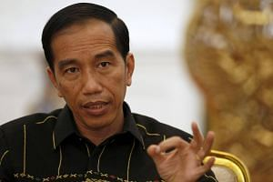 Indonesian President Joko Widodo gesturing during an interview with Reuters at the presidential palace in Jakarta, Indonesia, on Feb 10, 2016.