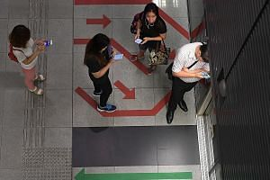 Circle Line users at Buona Vista MRT station yesterday. A signal interference first disrupted services on the Circle Line for a week in late August, resulting in slower train speeds and reduced service frequency. It resurfaced on Wednesday after a re