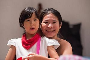 Ms Sally Kwek with her nine-year-old daughter Jarene, who has been attending the Cerebral Palsy Alliance Singapore School for the past two years. Jarene's teachers believe in her, accept her differences and are committed to bringing out the best in h