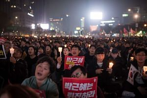 Demonstrators gather during a protest calling for the resignation of South Korean President Park Geun Hye in Gwanghwamun square in Seoul on Nov 5, 2016.