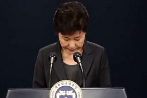 South Korean President Park Geun Hye bowing in apology as she delivers an address to the nation at the presidential office Cheong Wa Dae in Seoul, South Korea, on Nov 4, 2016