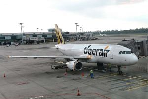 A Tigerair flight (file picture) from Hong Kong to Singapore was turned back before take-off after the plane's crew noticed cracks in the aircraft's windscreen.