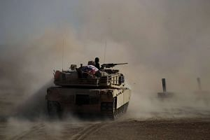An Iraqi tank fires at ISIS positions during a clash in the Shahrazad district of eastern Mosul, Iraq, on Nov 6, 2016.