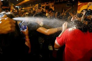 Police using pepper spray on demonstrators during a protest in Hong Kong, on Nov 6, 2016.