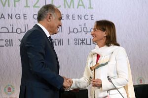 French Environment Minister Segolene Royal (right) and COP22 president Salaheddine Mezouar attend the opening session of the COP22 climate talks in Marrakesh on Nov 7, 2016.