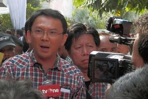 Jakarta Governor Basuki Tjahaja Purnama speaking to reporters in 2012.