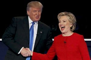 Republican US presidential nominee Donald Trump shakes hands with Democratic US presidential nominee Hillary Clinton at the conclusion of their first presidential debate at Hofstra University in Hempstead, New York, US on Sept 26, 2016.
