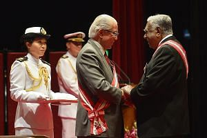 Mr Nathan receiving the Order of Temasek (First Class) from President Tan in 2013. As Prime Minister, Mr Lee has worked closely with two elected presidents, Mr Nathan and Dr Tan.