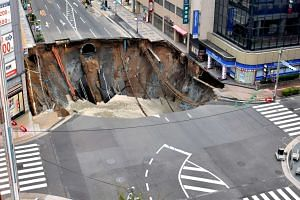 Work to refill the giant sinkhole in Fukuoka, Japan, has begun, city officials said on Nov 10, 2016.