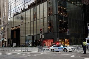 A New York City Police (NYPD) car is parked outside the security perimeter for the Trump Tower following President-elect Donald Trump's election victory, in New York City, US, on Nov 10, 2016.
