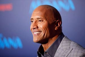 Actor Dwayne Johnson poses at the world premiere of Walt Disney Animation Studios'