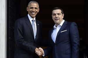 Greek Prime Minister Alexis Tsipras (right) welcomes US President Barack Obama before their meeting in Athens on Nov 15, 2016.