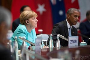 German Chancellor Angela Merkel (left) and US President Barack Obama attend the opening ceremony of the G20 Summit at the International Expo Center in Hangzhou on Sept 4, 2016.