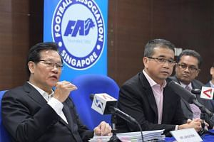 Football Association of Singapore (FAS) vice-president Lim Kia Tong (left) speaking at the FAS Extraordinary General Meeting (EOGM) on Nov 7, 2016. With him are fellow FAS vice-president Edwin Tong (centre) and president Zainudin Nordin.