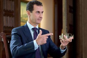 Syrian President Bashar al-Assad speaking during an interview with Denmark's TV2 channel.