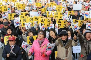 Participants opposing the resignation of President Park Geun Hye in a rally in front of a railway station in central Seoul on Nov 17, 2016.