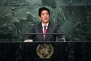 Japan's Prime Minister Shinzo Abe addresses the 71st session of the United Nations General Assembly at the UN headquarters in New York on Sept 21, 2016.