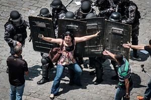 Rio de Janeiro state public servants protest against austerity measures in front of the Rio de Janeiro state Assembly on Nov 16, 2016.