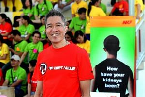 Mr Edmund Kwok at a healthy lifestyle walk organised for NKF staff. He often promoted sporting activities as a fund-raising platform and to encourage patients to lead healthier lives.