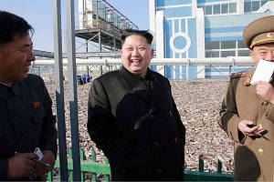 North Korean leader Kim Jong-Un (centre) visiting an army fishery in a photo released on Nov 17, 2016.