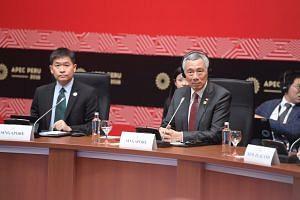 PM Lee and Luke Goh, Deputy Secretary (Trade) MTI (left), at the TPP Leaders meeting in Lima, Peru on Nov 19, 2016.