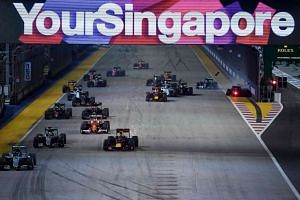 Mercedes AMG Petronas F1 Team's German driver Nico Rosberg (left) leads the start of the race, as Sahara Force India F1 Team's German driver Nico Hulkenberg (right) crashes during the Formula One Singapore Grand Prix in Singapore on Sept 18, 2016.