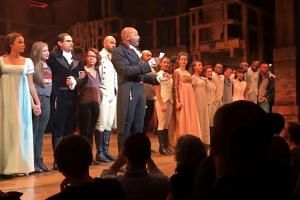 The cast of Hamilton deliver their message as Mike Pence is leaving in a still from online footage.