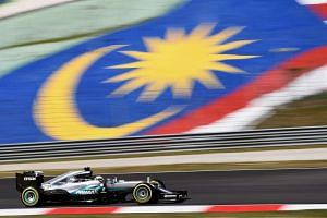 Mercedes AMG Petronas F1 Team's British driver Lewis Hamilton drives his car during the first free practice session of the Formula One Malaysia Grand Prix in Sepang.