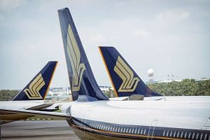 Singapore Airlines aircraft sit at Changi Airport in Singapore.