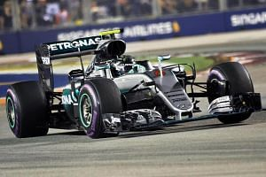 Mercedes AMG Petronas F1 Team's German driver Nico Rosberg takes a corner during the Formula One Singapore Grand Prix in Singapore on Sept 17, 2016.