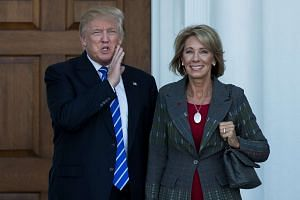 Mr Donald Trump and Ms Betsy DeVos after their meeting at Trump International Golf Club on Nov 18, 2016.
