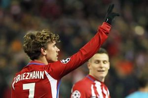 Atletico Madrid's French striker Antoine Griezmann (left) celebrates after scoring the 2-0 lead.