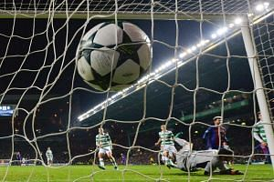 The ball slams into the back of the net after Lionel Messi scores from the penalty spot for Barcelona.