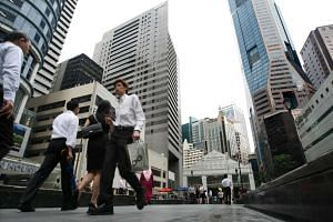 Office workers in Shenton Way.The unemployment rate in Singapore remained stable over the third quarter of the year, but total employment fell.
