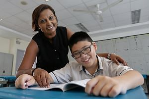 Chua Chu Kang Primary pupil Gabriel Tay with his form teacher, Madam Lakshimi Arivananthan, 36. Gabriel was born with bilateral optic atrophy, an eye disorder.