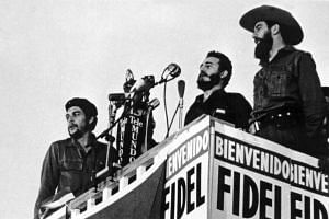 This handout picture by the Consejo de Estado was taken on January 8, 1959 and shows Cuban leader Fidel Castro (C) delivering a speech next to Camilo Cienfuegos (R) and Ernesto Che Guevara (L) in Havana.