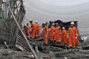 Chinese rescuers work at the accident site at the Fengcheng power plant in Yichun City on Nov 24, 2016.