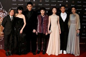(From left) Peter Ho-sun Chan, Sandra Ng, Toby Lee, Leah Dou, Zhou Dongyu, Derek Tsang and Ma Sichun pose on the red carpet at the 53rd Golden Horse Awards in Taipei on Nov 26, 2016.