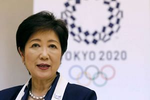 Tokyo Governor Yuriko Koike speaks in front of Tokyo 2020 Olympics emblem during an interview with Reuters at Tokyo Metropolitan Government Building in Tokyo on Oct 12, 2016.