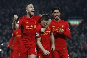 Liverpool's James Milner celebrates scoring their second goal with team mates.