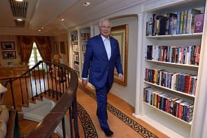Malaysian Prime Minister Najib Razak arrives for an interview with The Star newspaper in the library of his official residence.