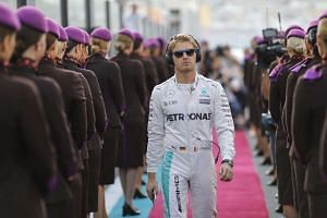 Nico Rosberg walks during the drivers track parade event of the Formula One Grand Prix of Abu Dhabi at Yas Marina Circuit in Abu Dhab on Nov 27, 2016.